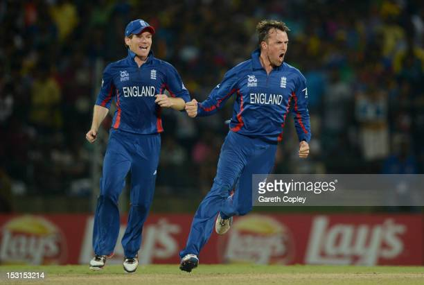 Graeme Swann of England celebrates with Eoin Morgan after dismissing Kumar Sangakkara of Sri Lanka during the ICC World Twenty20 2012 Super Eights...