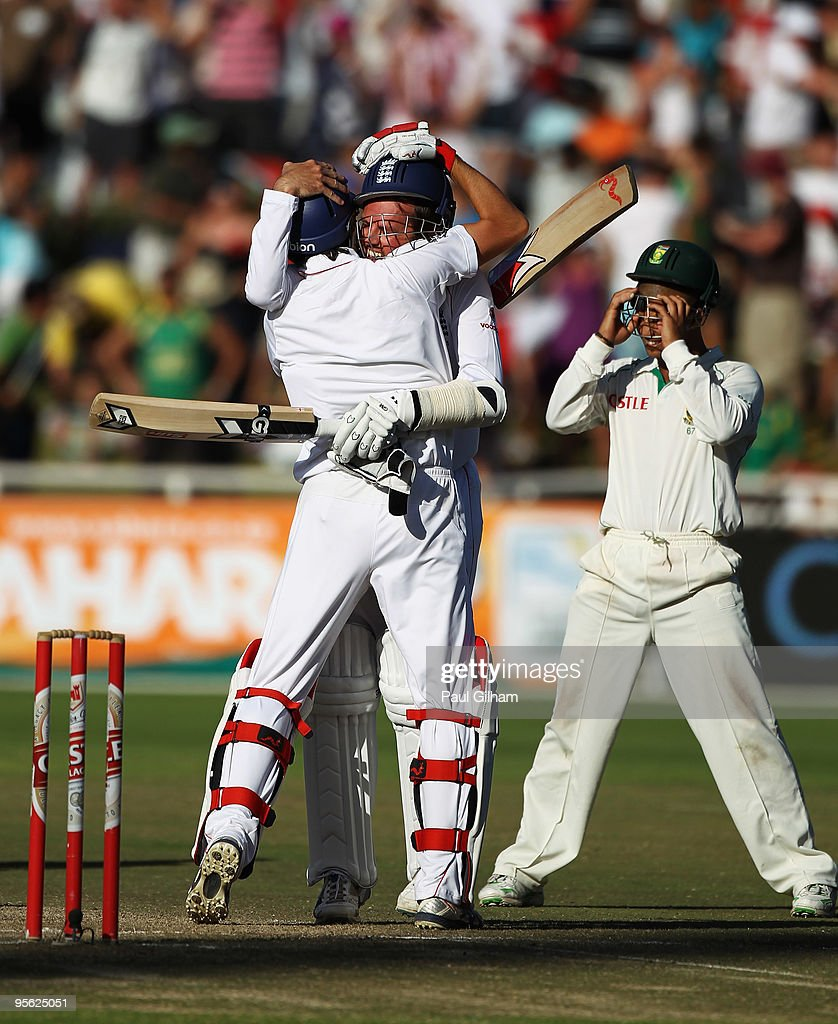 Graeme Swann of England celebrates with Graham Onions of England as Ashwell Prince of South Africa looks on after England drew the match against...