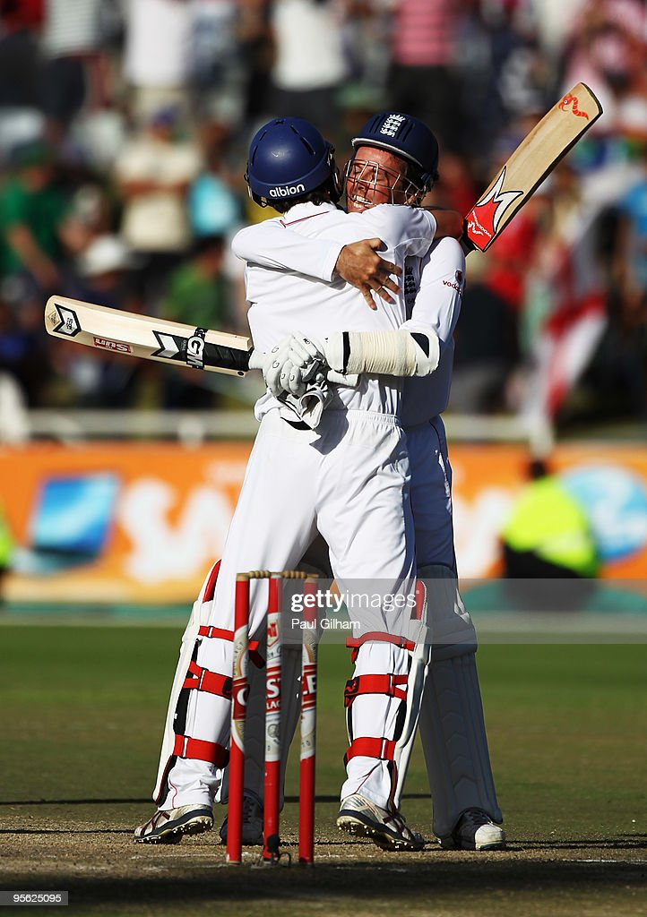 Graeme Swann of England celebrates with Graham Onions of England after England drew the match against South Africa during day five of the third test...