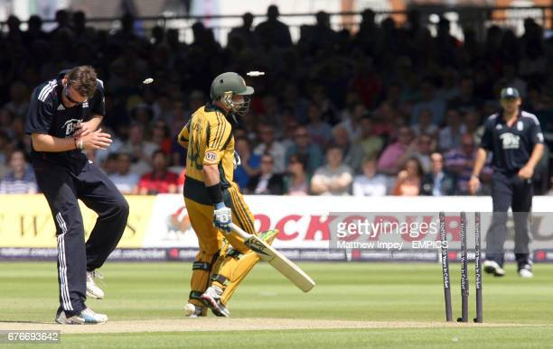 Graeme Swann of England ducks for cover from the flying bails after a run out attempt