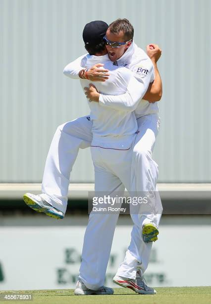 Graeme Swann of England hugs Alastair Cook after catching Michael Clarke of Australia during day one of the Third Ashes Test Match between Australia...