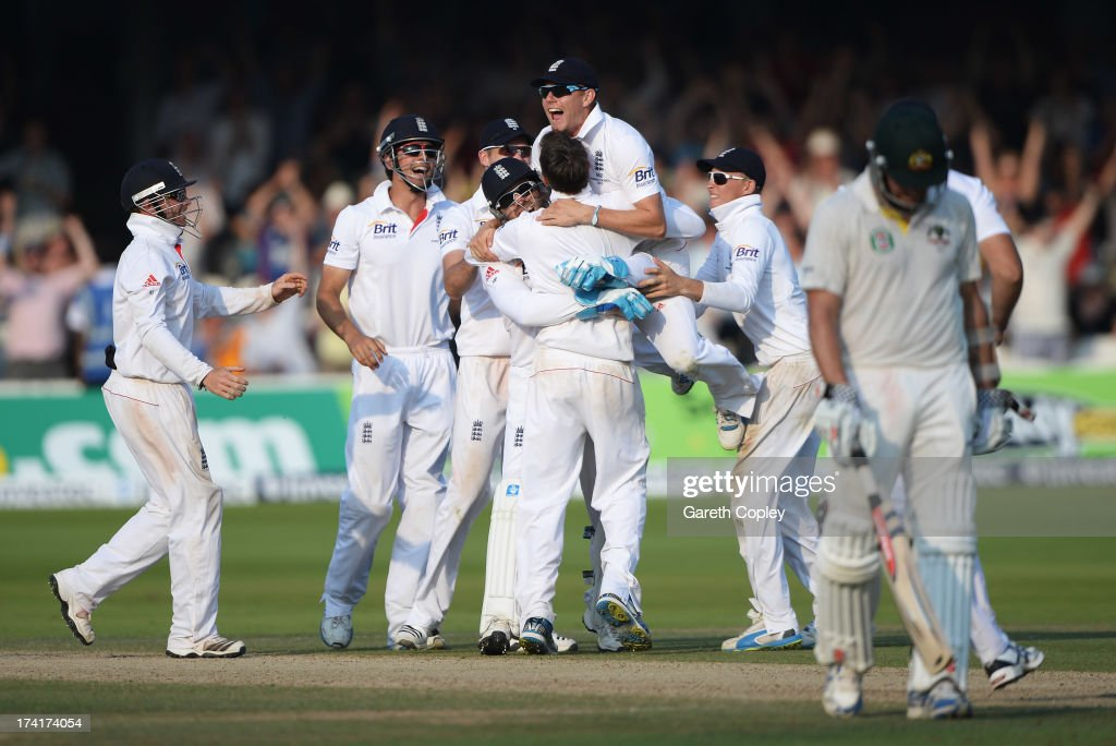 <a gi-track='captionPersonalityLinkClicked' href=/galleries/search?phrase=Graeme+Swann&family=editorial&specificpeople=578767 ng-click='$event.stopPropagation()'>Graeme Swann</a> of England is mobbed by team mates after taking the final wicket of James Pattinson of Australia giving England victory during day four of the 2nd Investec Ashes Test match between England and Australia at Lord's Cricket Ground on July 21, 2013 in London, England.