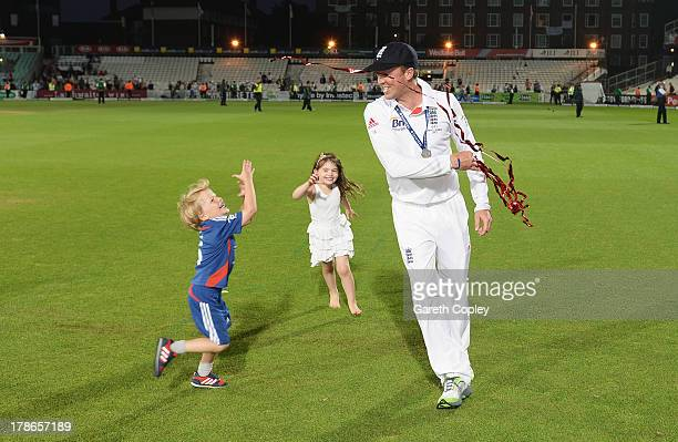 Graeme Swann of England plays with children after England won the Ashes Series during day five of the 5th Investec Ashes Test match between England...