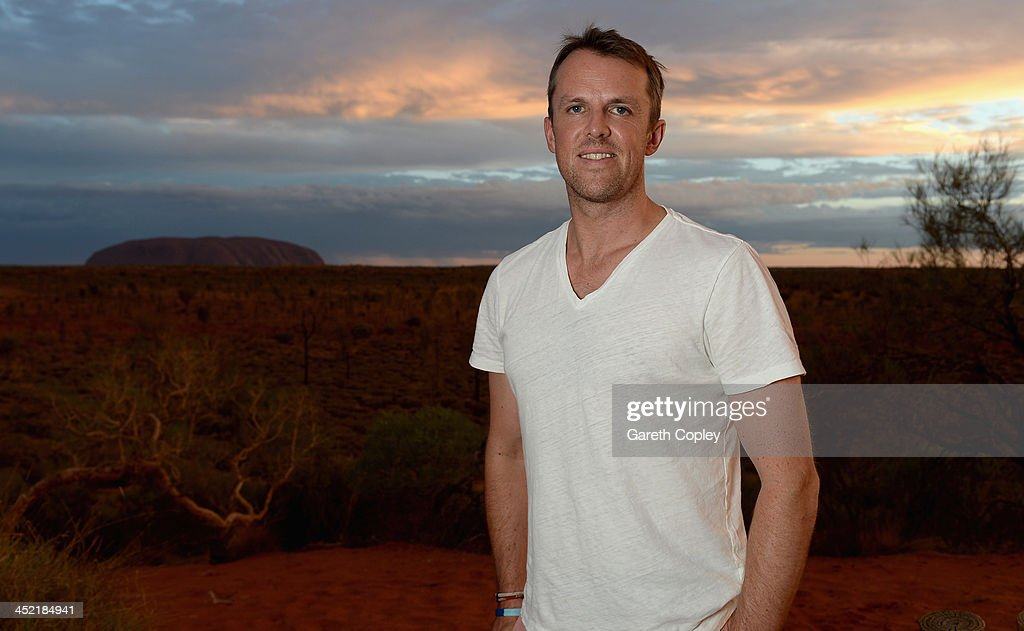 <a gi-track='captionPersonalityLinkClicked' href=/galleries/search?phrase=Graeme+Swann&family=editorial&specificpeople=578767 ng-click='$event.stopPropagation()'>Graeme Swann</a> of England poses for a photograph during a team visit to Uluru, which is also known as Ayers Rock, on November 26, 2013 in Ayers Rock, Australia.