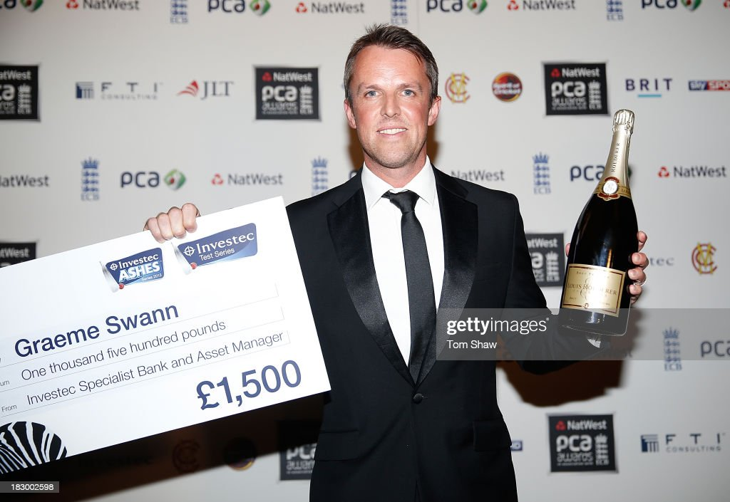 <a gi-track='captionPersonalityLinkClicked' href=/galleries/search?phrase=Graeme+Swann&family=editorial&specificpeople=578767 ng-click='$event.stopPropagation()'>Graeme Swann</a> of England poses with the Investec Test Player of the Summer Award during the Natwest PCA Awards dinner at The Roundhouse on October 3, 2013 in London, England.