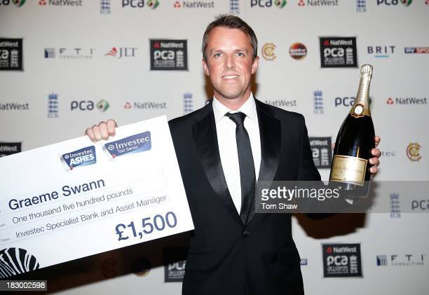Graeme Swann of England poses with the Investec Test Player of the Summer Award during the Natwest PCA Awards dinner at The Roundhouse on October 3...