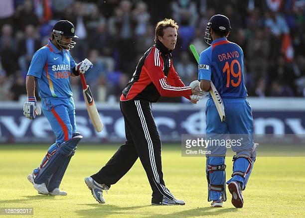 Graeme Swann of England shakes hands with Rahul Dravid of India after Dravid was dismissed by Swann in his last ever One Day International match...