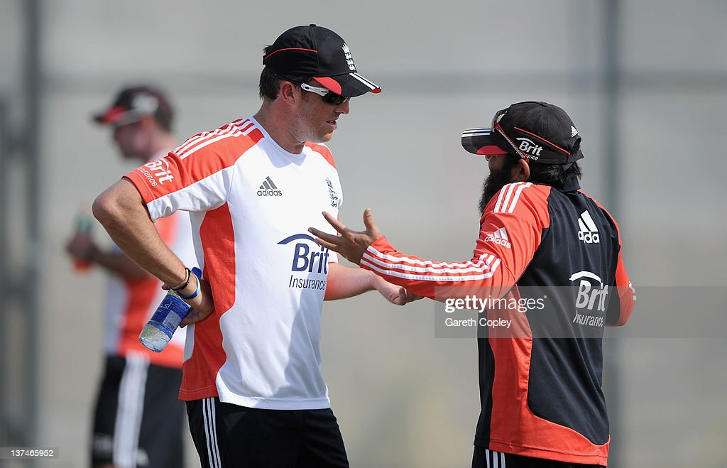 Graeme Swann of England speaks with spin bowling coach Mushtaq Ahmed during a nets session at The ICC Global Academy on January 21 2012 in Dubai...