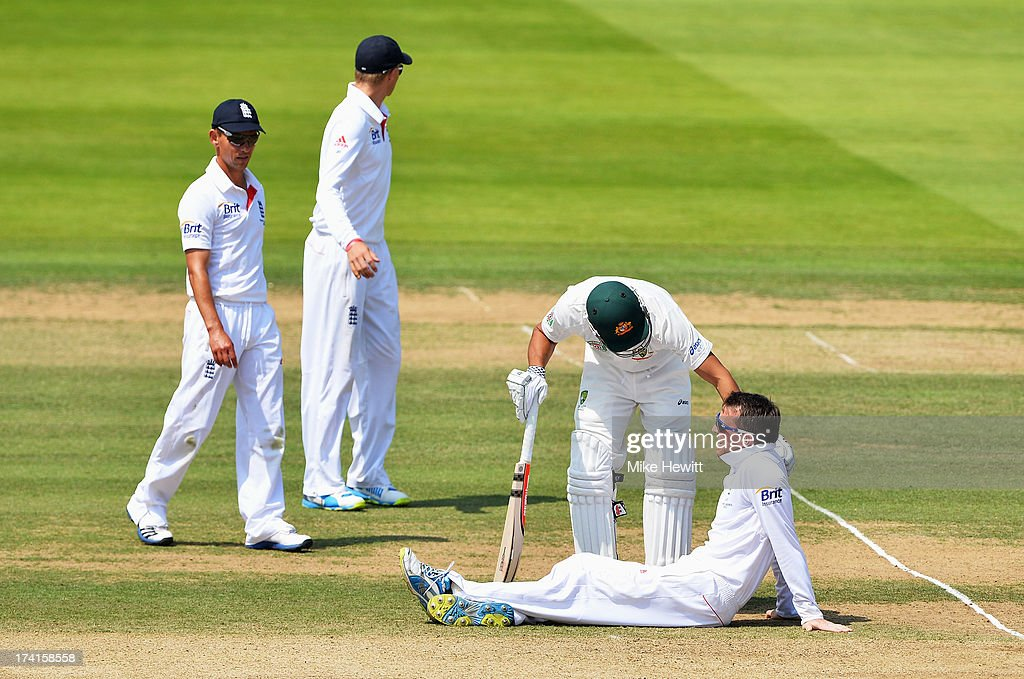 Graeme Swann of England talks to Usman Khawaja of Australia after falling to the ground during day four of the 2nd Investec Ashes Test match between England and Australia at Lord's Cricket Ground on July 21, 2013 in London, England.