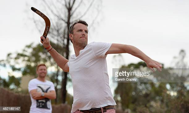 Graeme Swann of England throws a boomerang during a team visit to Uluru which is also known as Ayers Rock on November 26 2013 in Ayers Rock Australia
