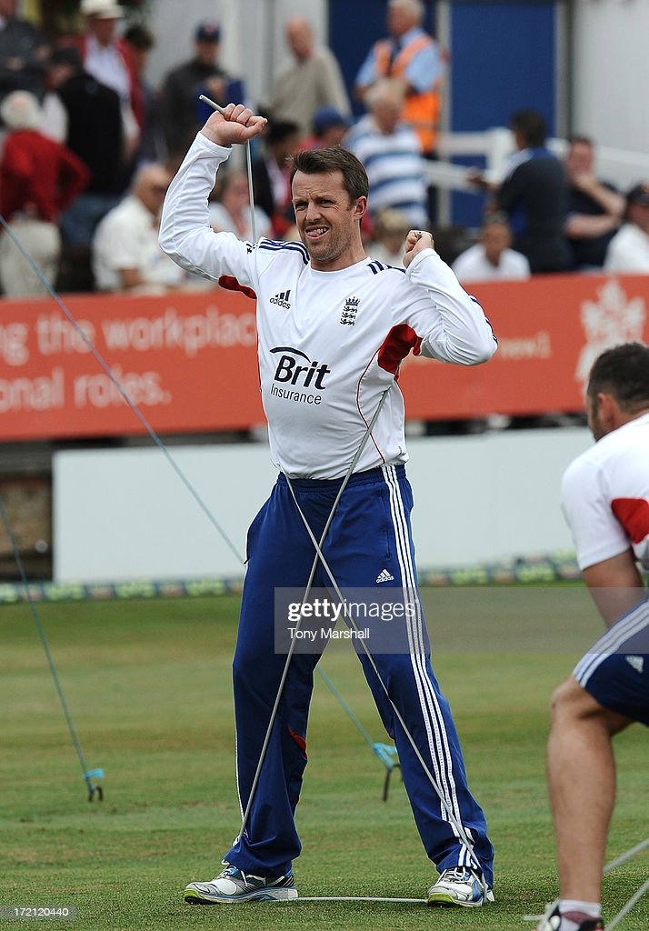 Graeme Swann of England warms up before the third day of the LV= Challenge match between Essex and England at The Ford County Ground on July 2, 2013 in Chelmsford, England.