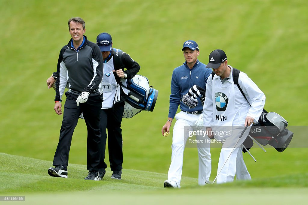 <a gi-track='captionPersonalityLinkClicked' href=/galleries/search?phrase=Graeme+Swann&family=editorial&specificpeople=578767 ng-click='$event.stopPropagation()'>Graeme Swann</a> walks with <a gi-track='captionPersonalityLinkClicked' href=/galleries/search?phrase=Danny+Willett&family=editorial&specificpeople=4488861 ng-click='$event.stopPropagation()'>Danny Willett</a> of England during the Pro-Am prior to the BMW PGA Championship at Wentworth on May 25, 2016 in Virginia Water, England.