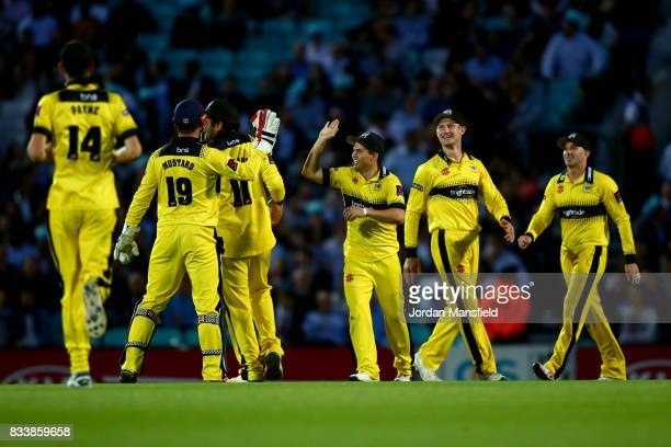 Graeme van Buuren of Gloucestershire celebrates with his teammates after catching out Rory Burns of Surrey during the NatWest T20 Blast match between...
