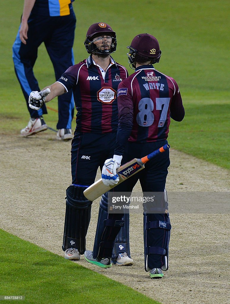 Graeme White of Northamptonshire celebrates hitting the winning runs with Steven Crook of Northamptonshire during the NatWest T20 Blast match between Northamptonshire and Derbyshire at The County Ground on May 27, 2016 in Northampton, England.