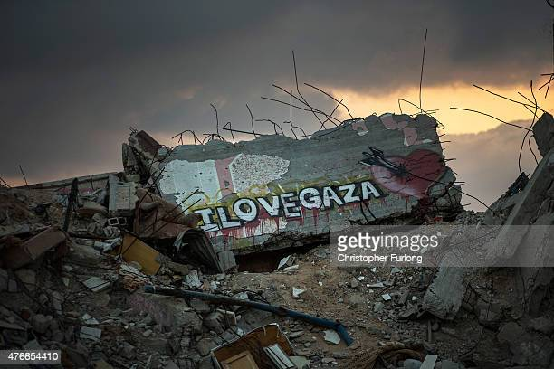 Graffiti adorns mounds of rubble bombed buildings continue to scar the landscape of Gaza on June 10 Gaza City Gaza The devastation across Gaza can...