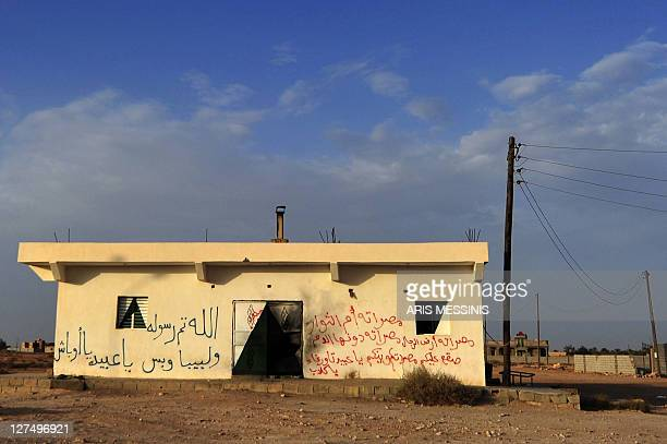 Graffiti against the people of Tawarga is painted on a house in the Libyan town on September 25 2011 The people of Tawarga who are mostly...