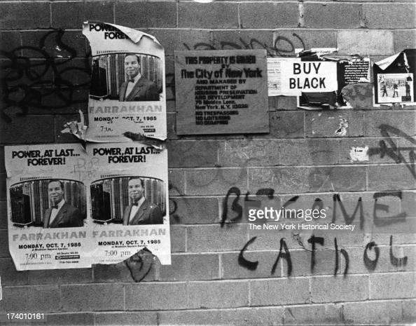 Graffiti and bills on building in Harlem include an ad for Farrakhan at Madison Square Garden 'Buy Black' 'Become Catholic' and 'This Property is...