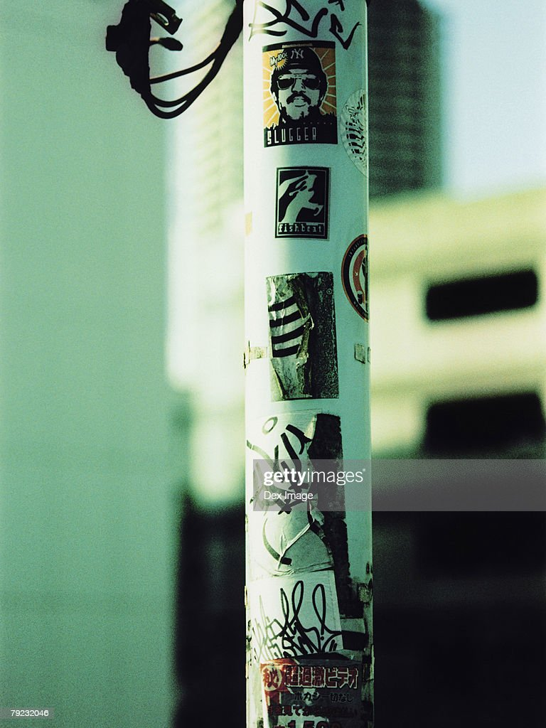 Graffiti and stickers on lamp post : Stock Photo