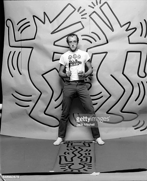Graffiti and visual artist Keith Haring photographed with one of his paintings in April 1984 Photo by Jack Mitchell/Getty Images