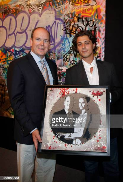 Graffiti artist Anthony Alberti also known as Mr One Teas poses with Prince Albert II of Monaco and his artwork 'Prince Albert and Charlene' and...