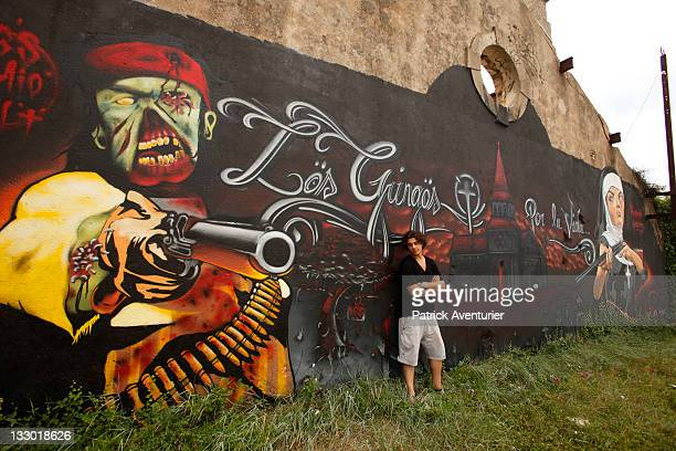 Graffiti artist Anthony Alberti also known as Mr One Teas work on the wall on July 30 2011 in La TurbieFranceThe streets of Monaco which are noted...