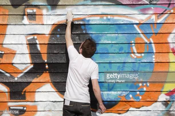 Graffiti artist creating new artwork at Five Pointz.