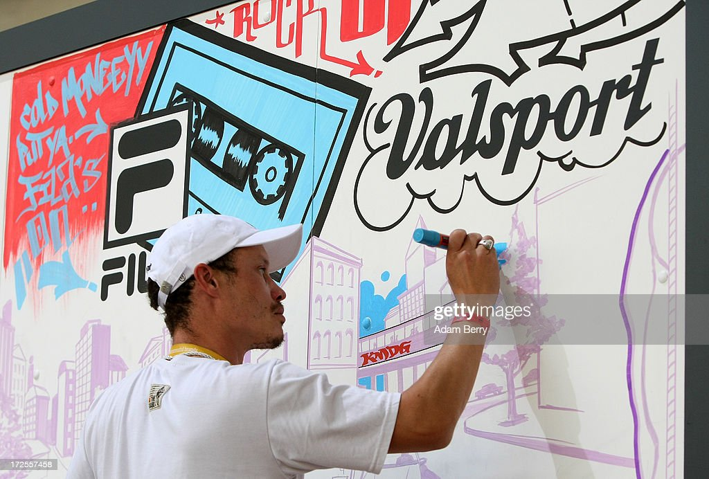 A graffiti artist draws a mural at the Bread and Butter trade show at the former Tempelhof airport during Mercedes-Benz Fashion Week in Berlin on July 3, 2013 in Berlin, Germany.