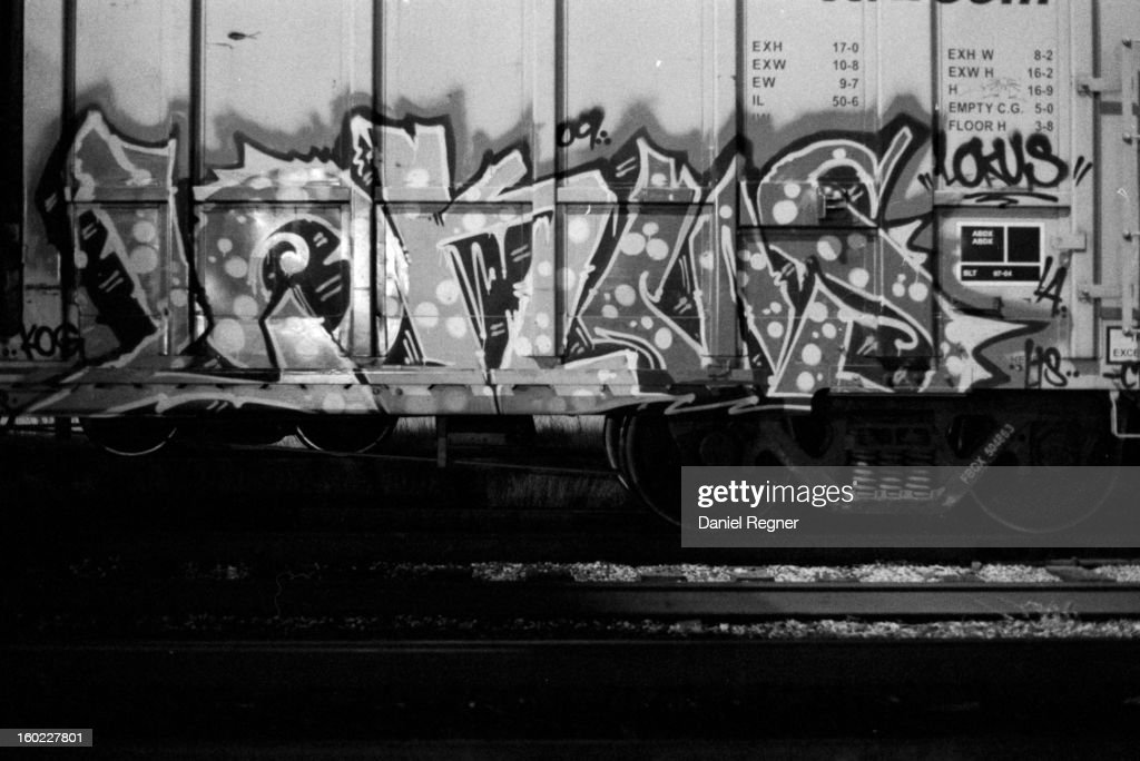 CONTENT] Graffiti can be seen on a train-car. The shot is high contrast and black and white. A good image to show how graffiti is a frequent addition to urban areas.