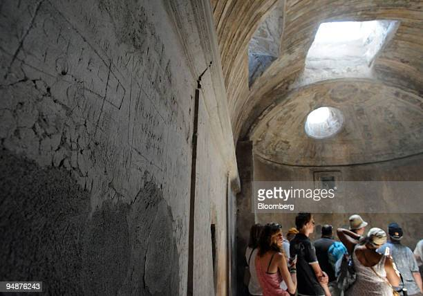 Graffiti carved into the walls of the Calidarium of Pompeii the city destroyed by the eruption of the volcano Vesuvius in AD 79 in Pompeii Italy on...