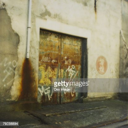 Graffiti covered wall and door : Stock Photo