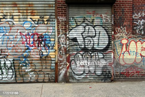 Graffiti covered wall and shutter NYC background