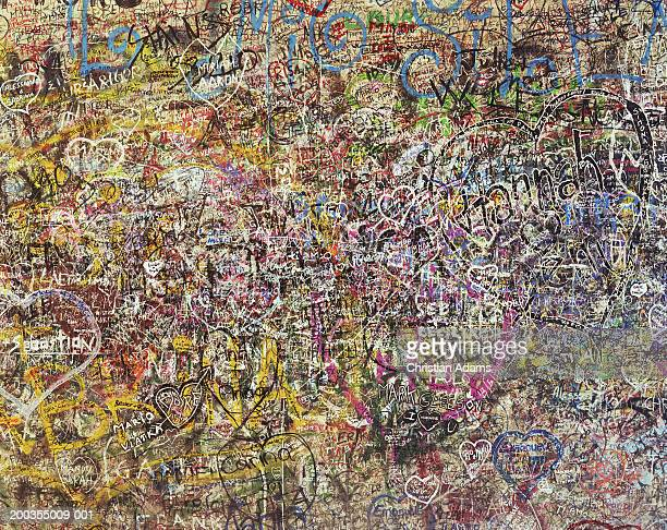 Graffiti covered wall, full frame