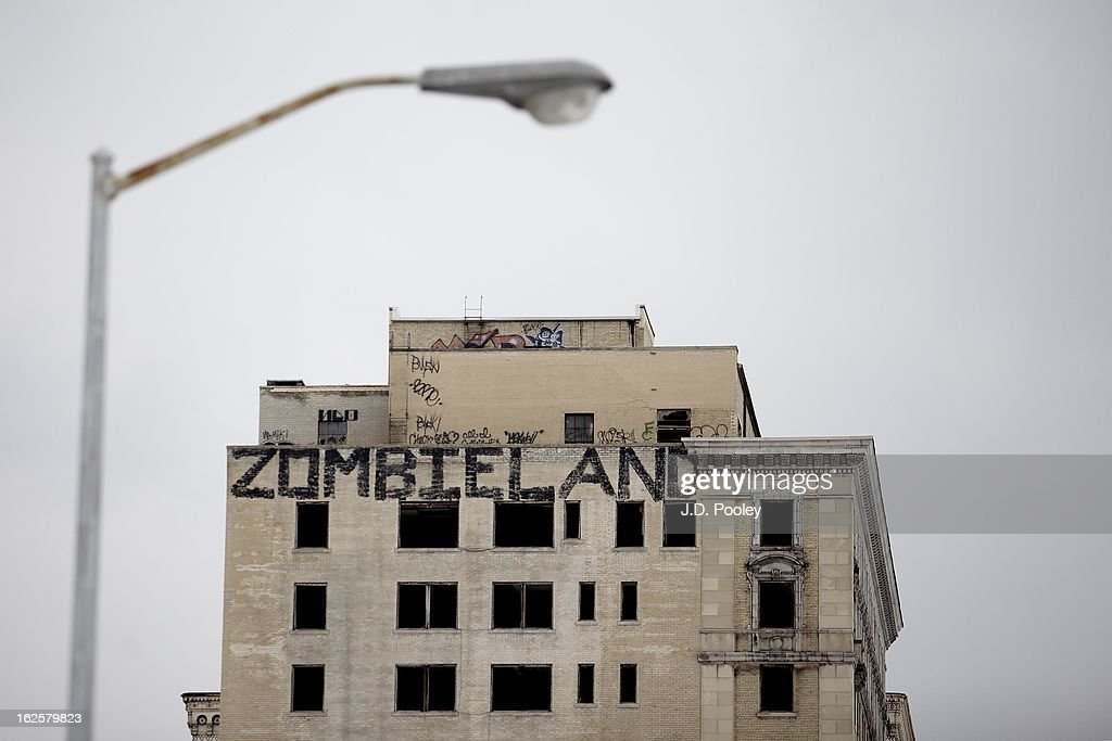 Graffiti covers an abandoned building February 24, 2013 in Detroit, Michigan. The city of Detroit has faced serious economic challenges in the past decade, with a shrinking population and tax base while trying to maintain essential services. A financial review team issued a finding on February 19 identifying the city as being under a 'financial emergency.' Michigan Gov. Rick Snyder has 30 days from the report's issuance to officially declare a financial emergency, which could result in the governor appointing an emergency financial manager to oversee Detroit's municipal government.