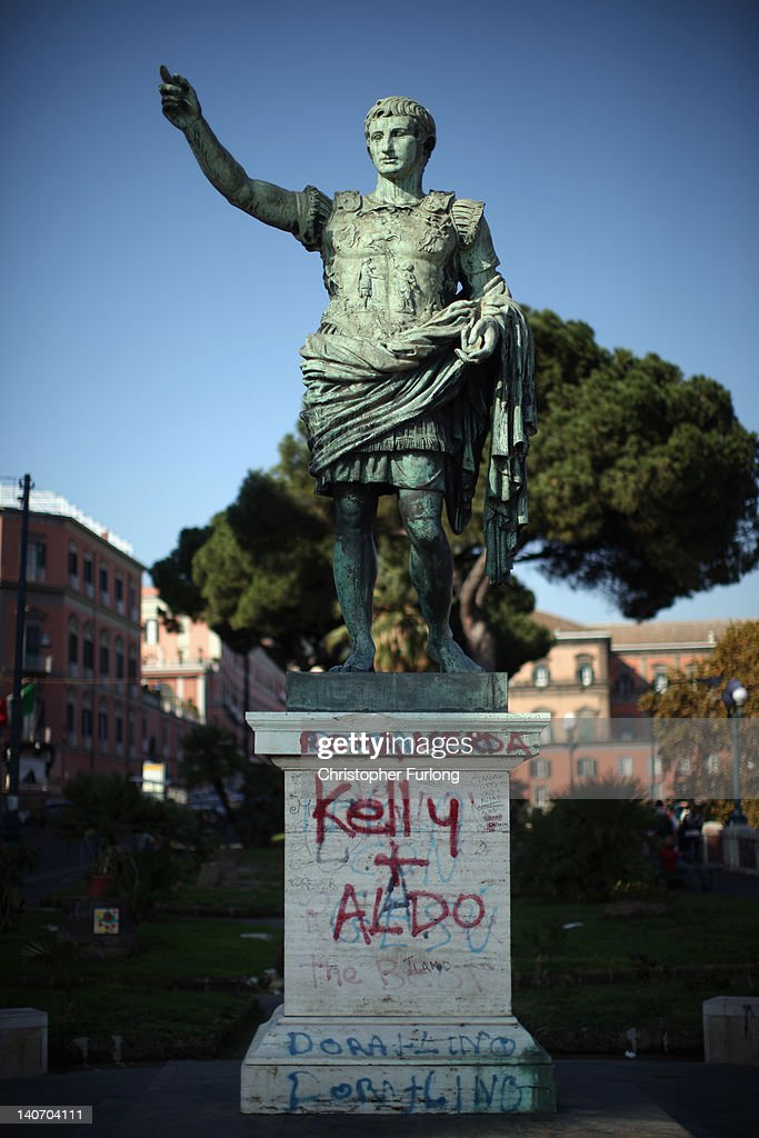 Graffiti covers an historic statue in Naples on November 14, 2011 in Naples, Italy. Naples is famed for it's narrows streets, pizza, Mount Vesuvius and Unesco protected buildings.
