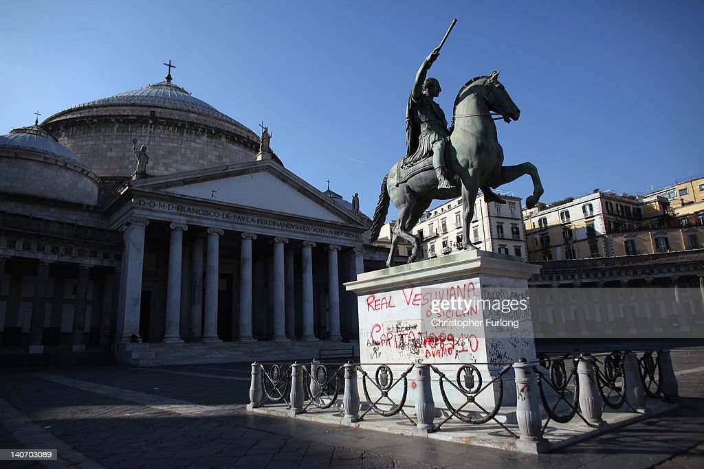 Graffiti covers an historic statue in Piazza Plebiscito on November 14, 2011 in Naples, Italy. Naples is famed for it's narrow streets, pizza, Mount Vesuvius and Unesco protected buildings.