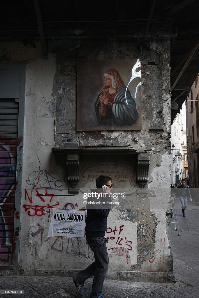 Graffiti covers some of the historic buildings of Naples on November 16, 2011 in Naples, Italy. Naples is famed for it's narrows streets, pizza, Mount Vesuvius and Unesco protected buildings.