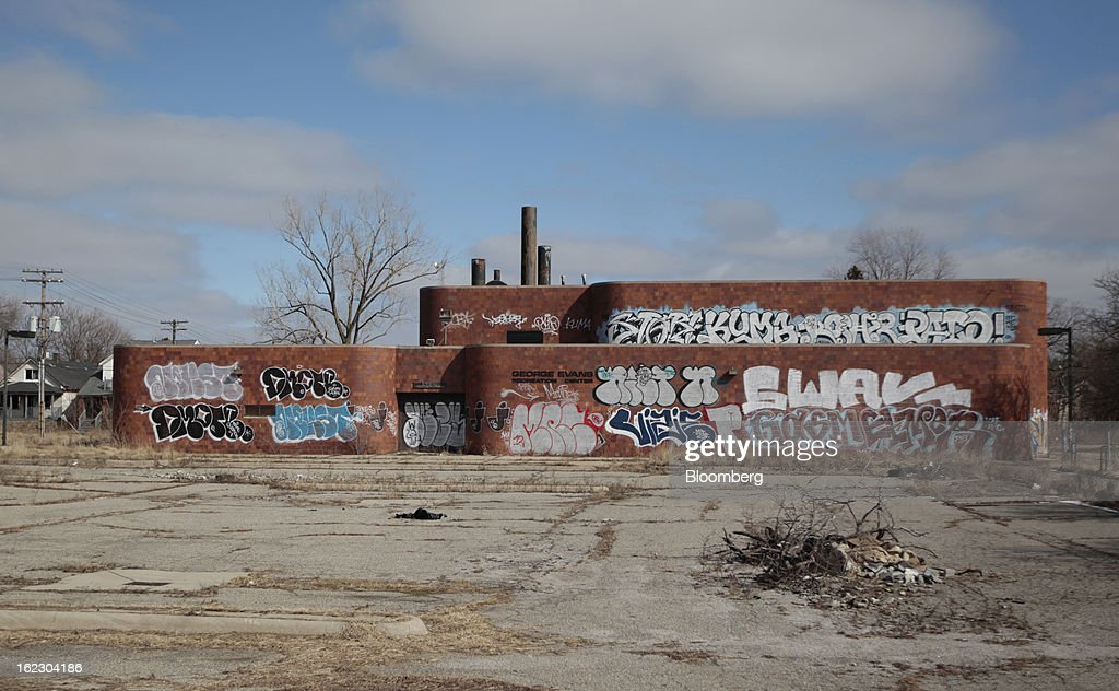 Graffiti covers the George Evans Recreation Center, which is permininatly closed, in Detroit, Michigan, U.S., on Thursday, Feb. 21, 2013. A fiscal emergency grips Detroit, according to a report ordered by Governor Rick Snyder, that opens a path to a state takeover of General Motors Co.'s home town, citing deficits that have stymied city officials after a $326.6 million gap last year. Photographer: Jeff Kowalsky/Bloomberg via Getty Images