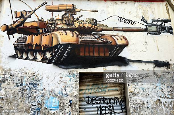 A graffiti entitled 'destructive media' is seen on the wall of an old abandoned shop in the Lebanese capital Beirut on May 29 2015 AFP PHOTO/JOSEPH...