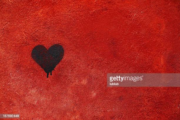 Graffiti heart spraypainted on red wall - Love Concept