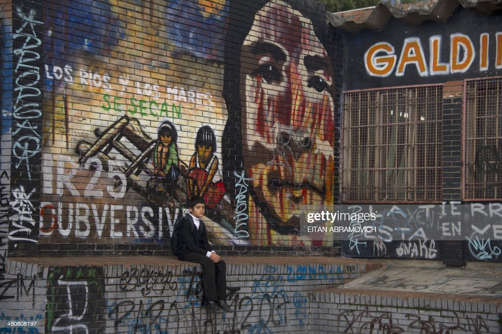 A graffiti in Bogota on November 19, 2013. The graffiti, once considered vandalism, is gaining more space in Bogota, with a city tour and the support of the mayor's office which provides walls, materials and fees to street artists. AFP PHOTO/Eitan Abramovich /
