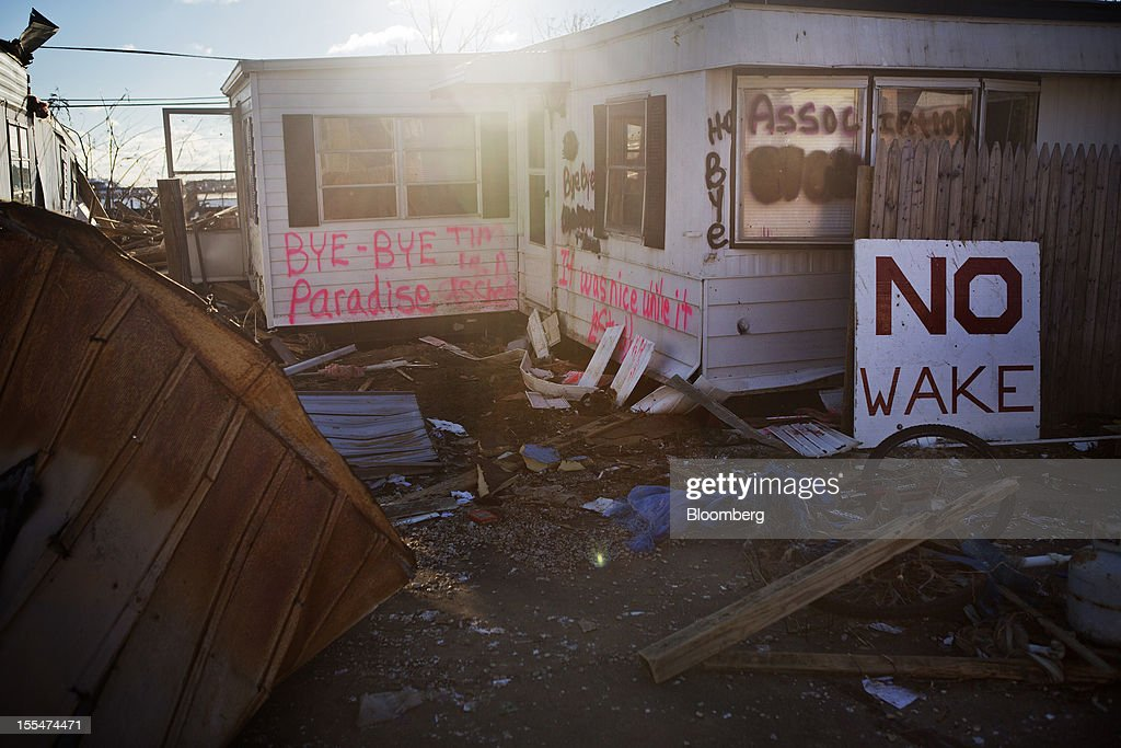 "Graffiti is scrawled on a mobile home damaged during Hurricane Sandy in the Paradise Park trailer park in Highlands, New Jersey, U.S. on Saturday, Nov. 3, 2012. Recovery progressed slowly in New Jersey, where Hurricane Sandy struck on Oct. 29. New Jersey Governor Chris Christie, a Republican, praised the ""patience and resilience"" of New Jerseyans and released a timeline Saturday of which neighborhoods without electricity should be restored over the next few days. Photograph: Victor J. Blue/Bloomberg via Getty Images"