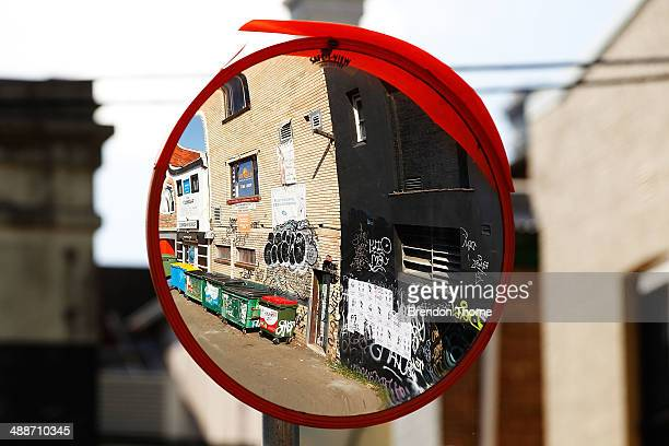 Graffiti is seen through a mirror of a laneway on May 8 2014 in Sydney Australia The Grafitti Control Amendment Act passed in the NSW legislative...