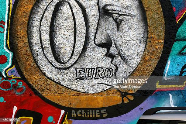 A graffiti of a Euro coin are drawn at a car park on July 9 2015 in Athens Greece The Greek government has only hours left to offer Eurozone...