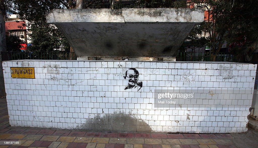 Graffiti of the Father of the Nation, Mahatma Gandhi at a public urinal in Hauz Khas Matket.