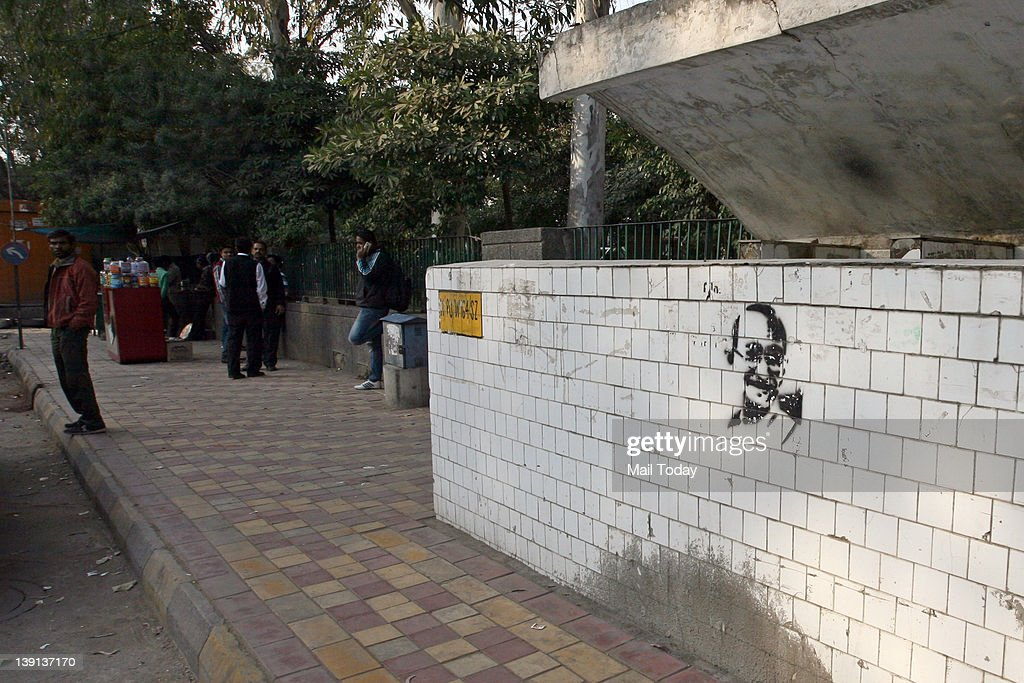 Graffiti of the Father of the Nation, Mahatma Gandhi at a public urinal in Hauz Khas Matket.