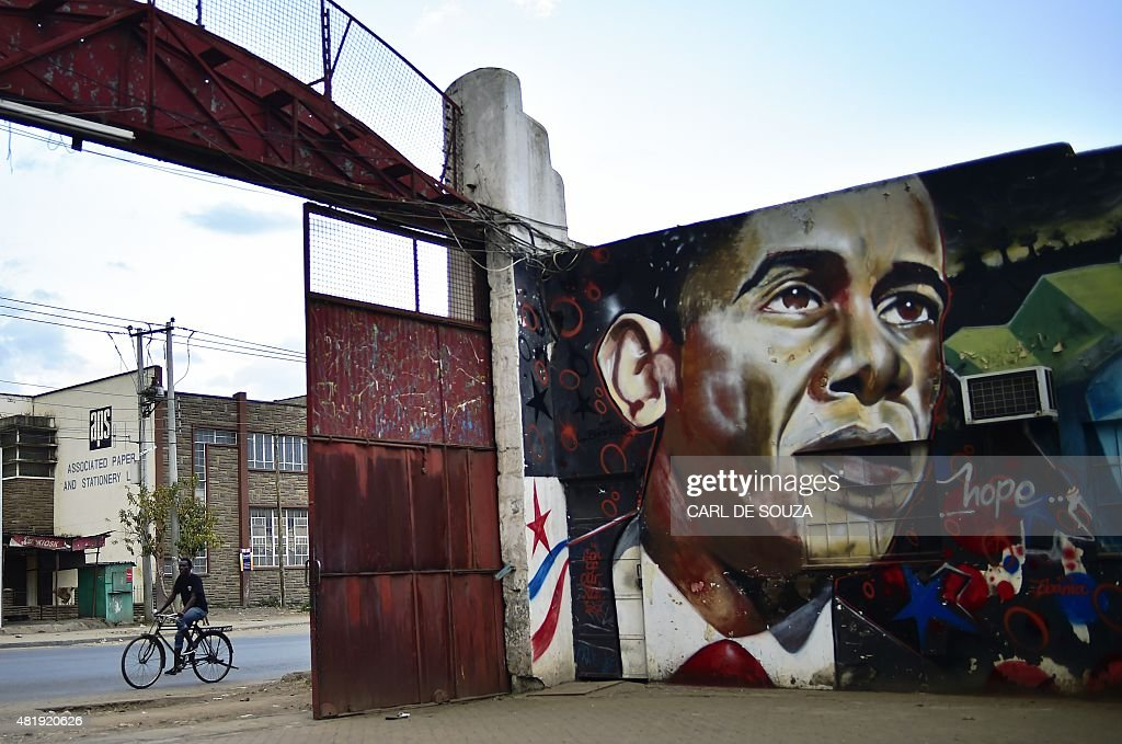 A graffiti of US President Barack Obama is seen on a wall in Nairobi on July 25 2015 Kenyans gathered in the city centre to watch US President Barack...
