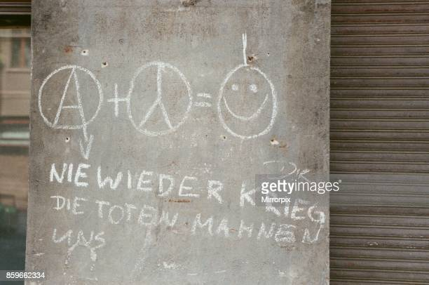 Graffiti on a residential wall in East Berlin Germany 22nd September 1989 the area is very much run down to unsanctioned immigration of large numbers...