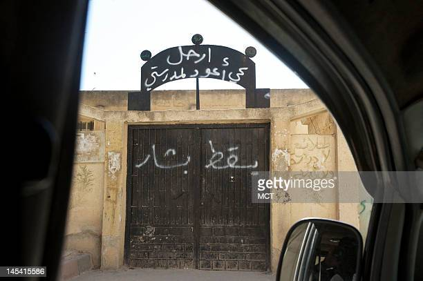 Graffiti on a school gate in Idlib province Syria reads 'Bashar down Leave because I want to go back to my school' May 27 2012 According to the...