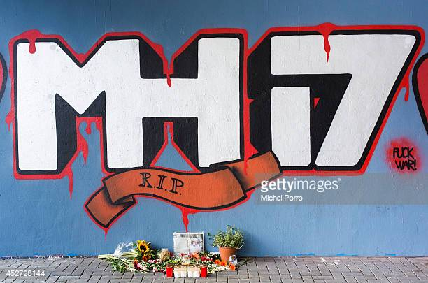 Graffiti on a wall commemorates the victims of the Malaysia Airlines Flight MH17 crash underneath a flyover July 26 2014 in Koog aan de Zaan The...