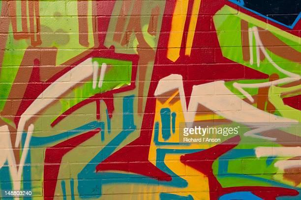 Graffiti on apartment building wall.